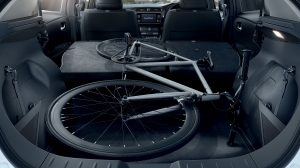 Nissan LEAF trunk with folded seats and a bicycle