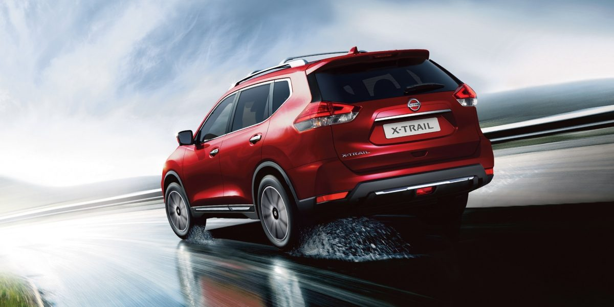 Nissan X-Trail rear view driving in the rain