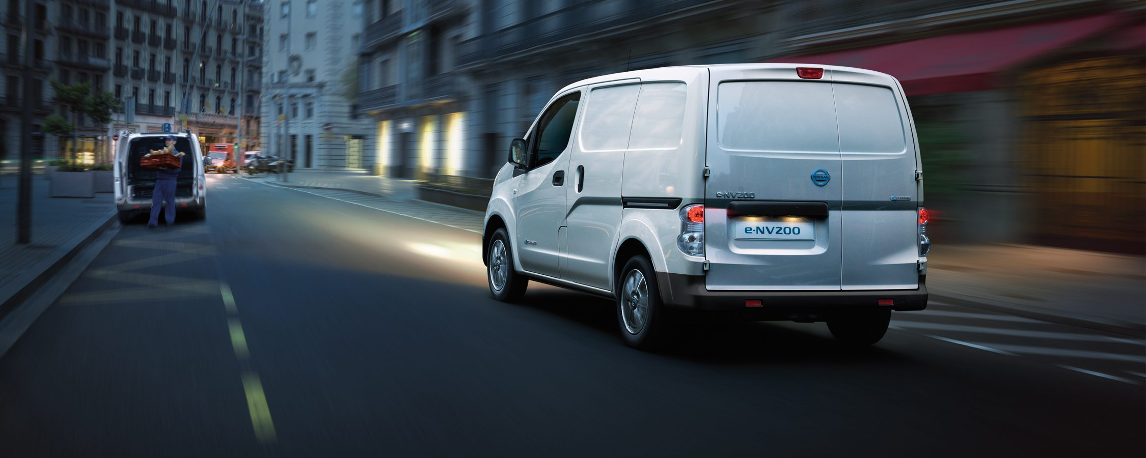 New Nissan e-NV200 VAN driving in the city
