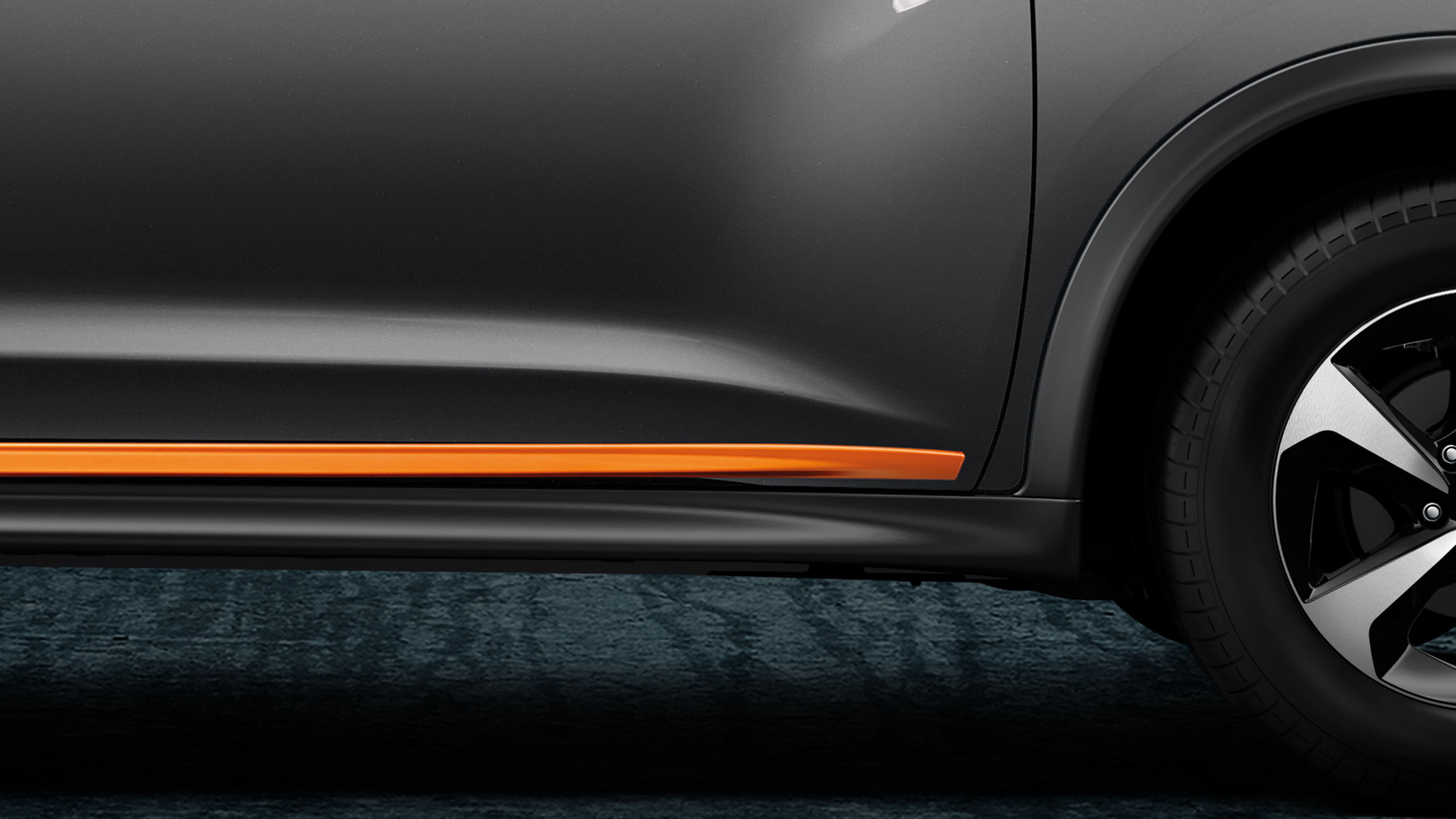 Orange accent on the bottom of the rear passenger door.