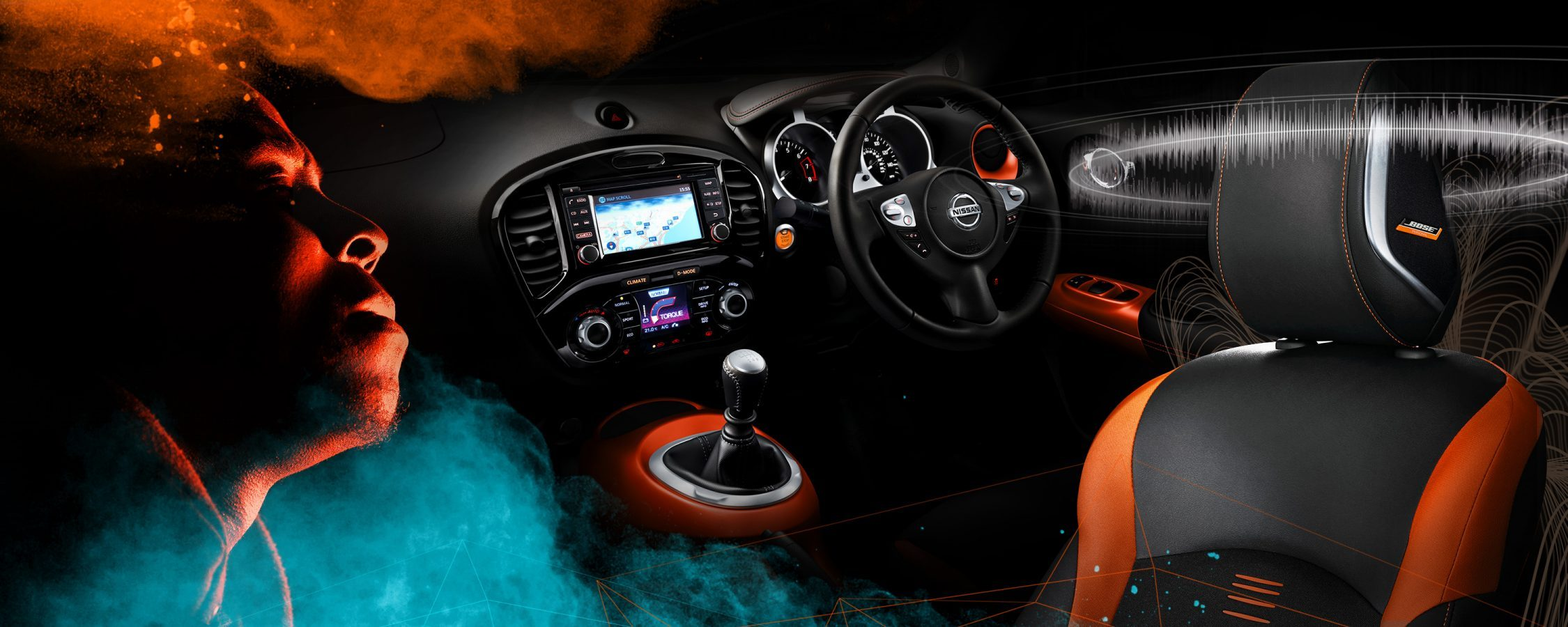 Black leather with orange accents interior of the JUKE with lit up sat nav display and audio soundwaves surrounding the driver's headrest.