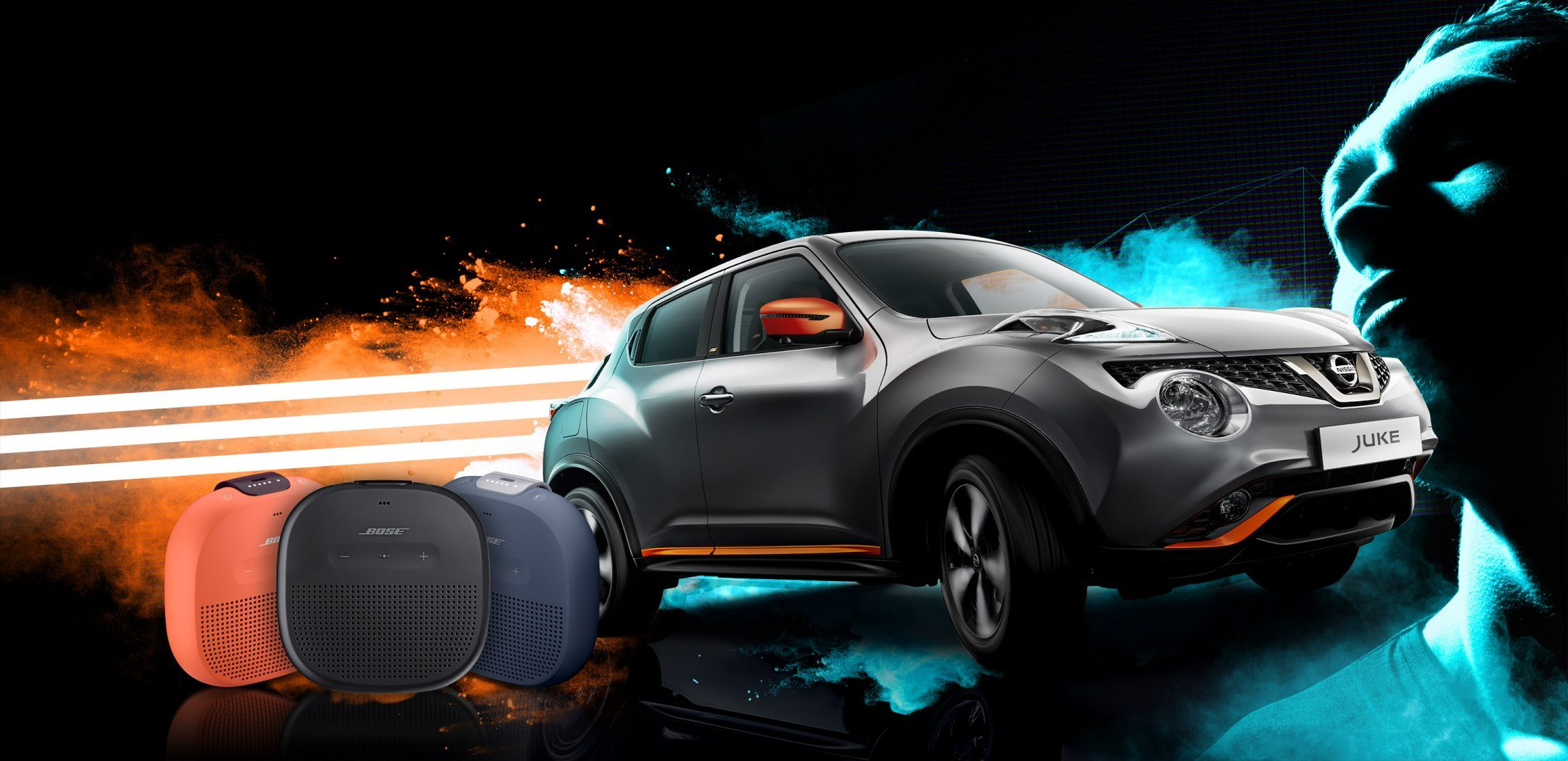 Grey Nissan JUKE with orange accents on the right, with the Orange, Blue and Black colour options of the BOSE Portable Speaker on the bottom left.