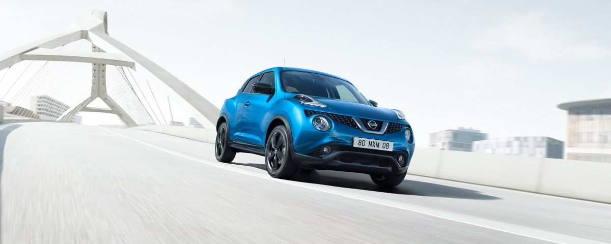 2018 Nissan JUKE driving shot on a bridge