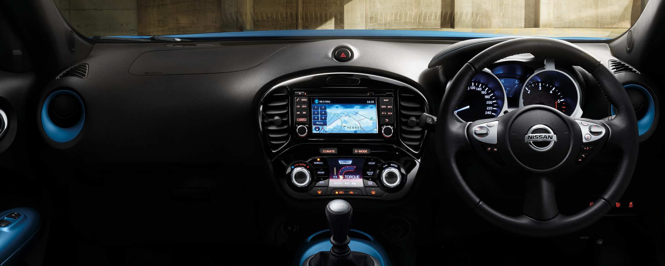 2018 Nissan JUKE interior showing dashboard, steering wheel and central console