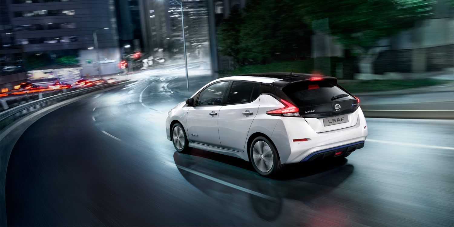 New Nissan LEAF driving in the city at night