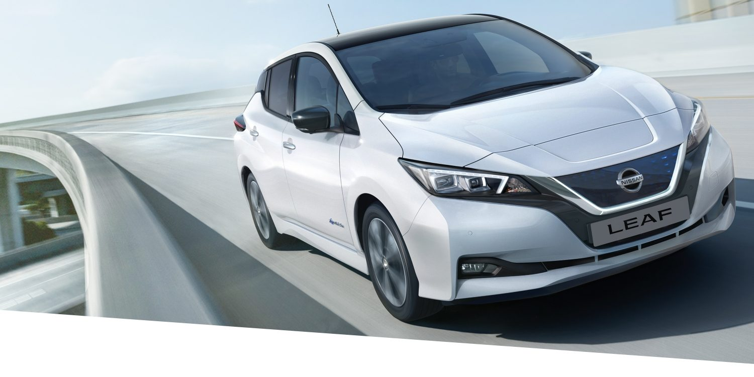 New Nissan LEAF shown from the front driving on a highway highlighting bold design