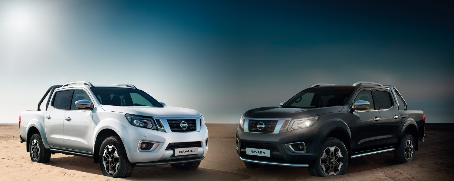 Two Nissan Navara 3/4 front views accessorized