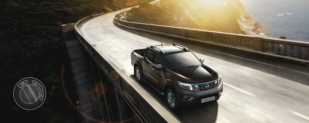 Nissan Navara 3/4 front high view driving shot on a bridge with 2 wheel drive illustration