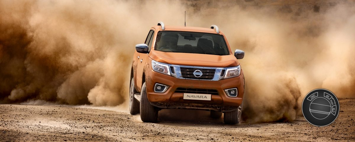 Nissan Navara driving shot in the desert with 4 wheel drive low illustration