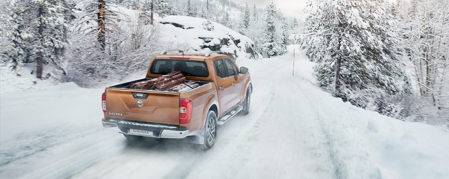 Nissan Navara rear driving shot in the snow