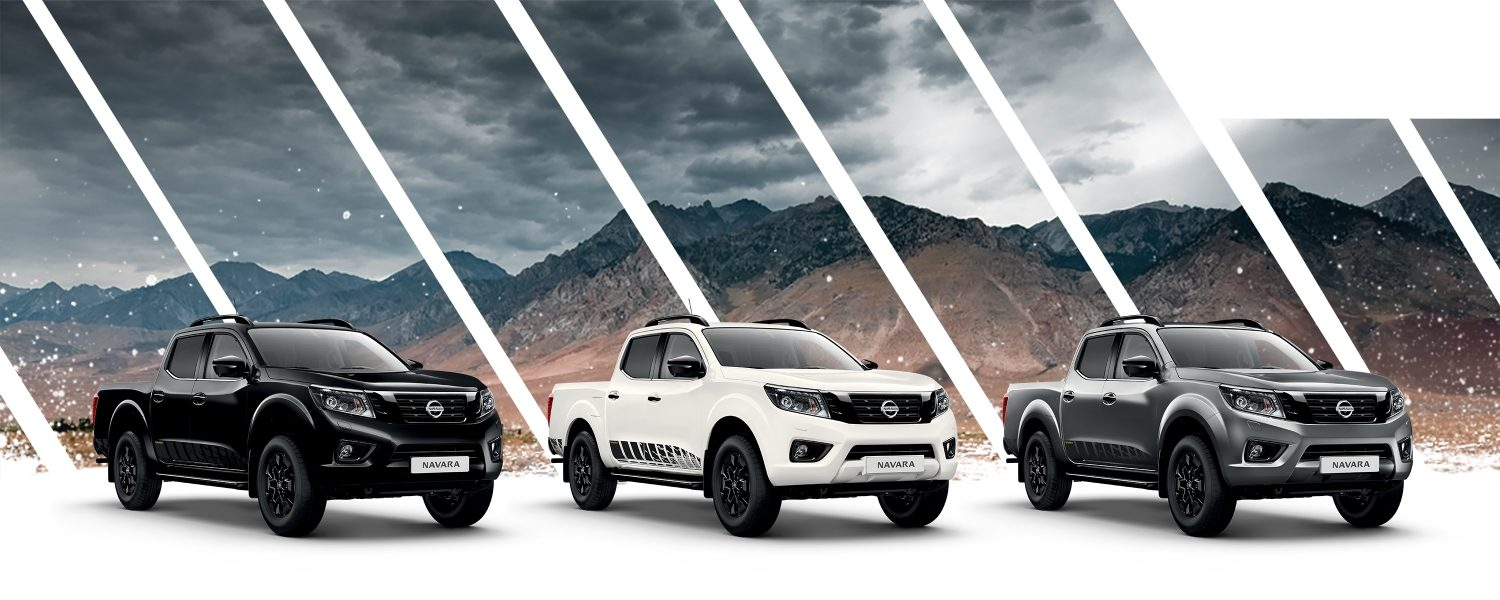 Nissan Navara N-Guard packshots in three colors available with a mountain background
