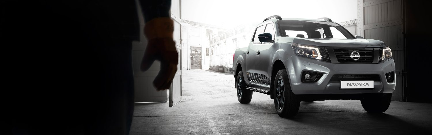 Nissan Navara N-Guard front shot entering a workshop