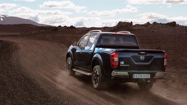Nissan Navara 3/4 rear view driving shot in Iceland