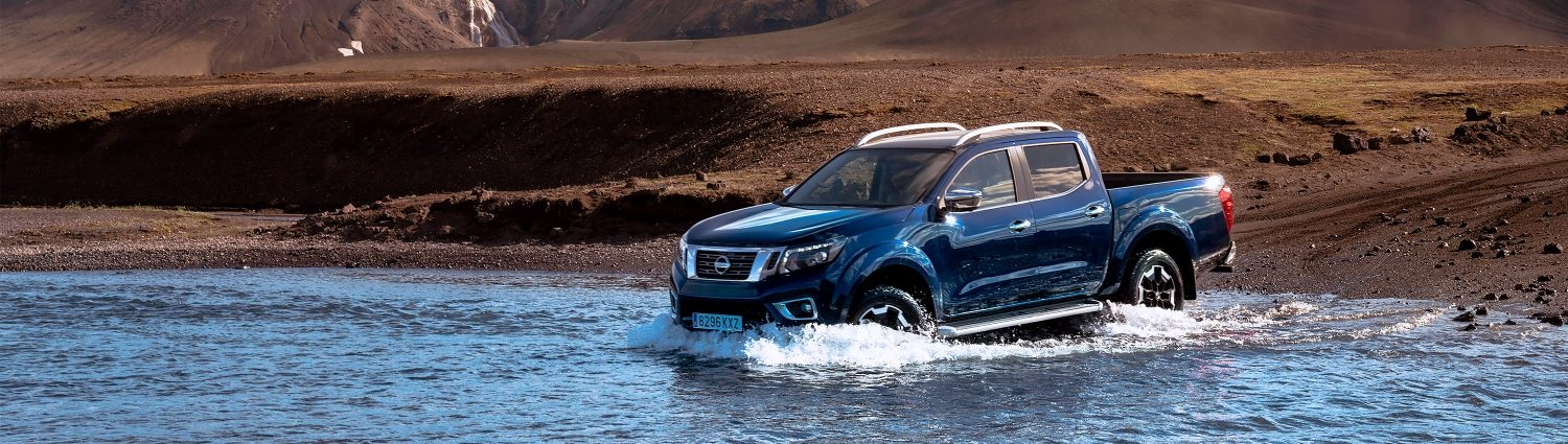Nissan Navara driving shot in the water in Iceland