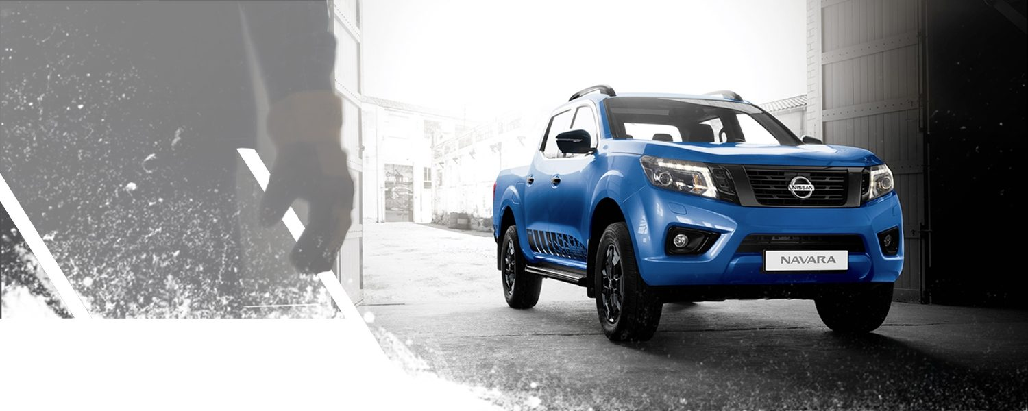 Nissan Navara N-Guard entering in a warehouse