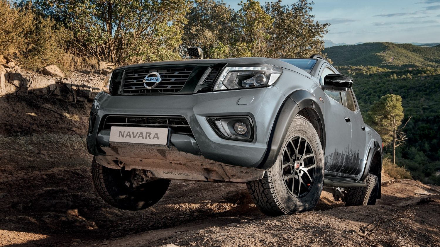 New Nissan Navara off-roader at32 with suspensions in action in extreme conditions