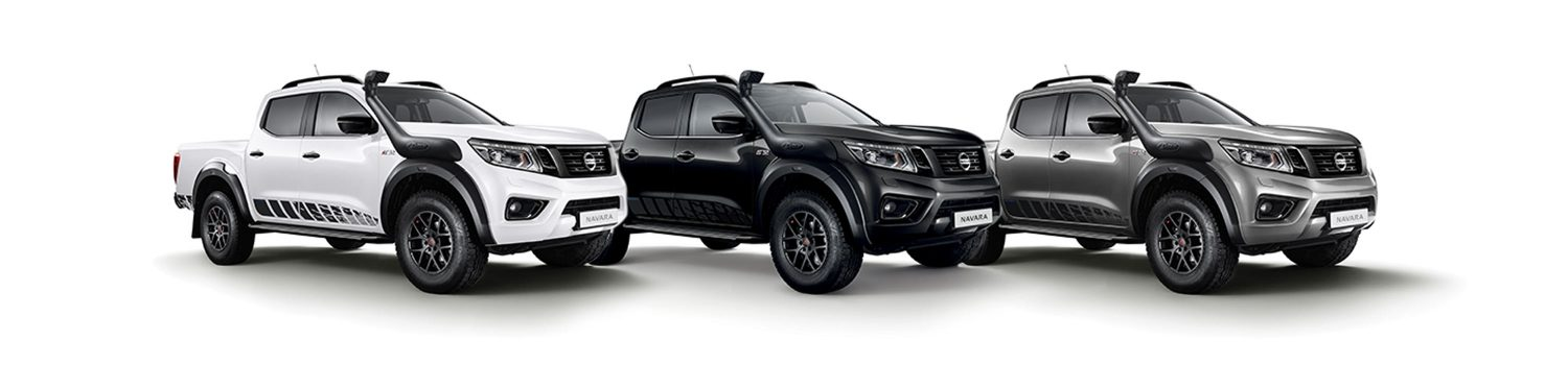 New Nissan Navara off-roader pick-up 3/4 front view in 3 different colours white black and grey