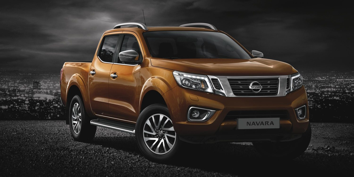 Nissan NP300 Navara Bronze - 3/4 front static view with cityscape in background