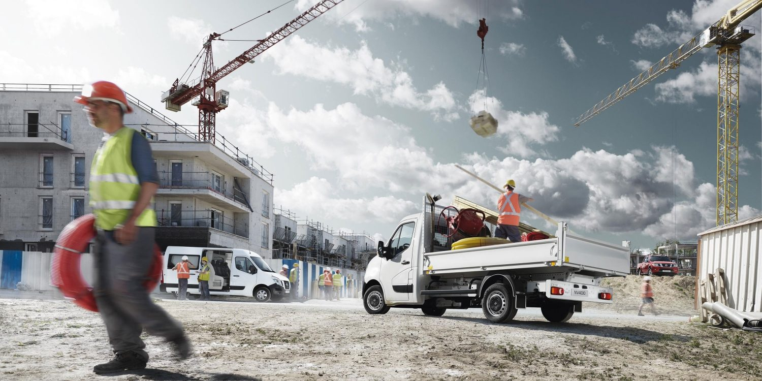 Nissan NV400 - Solid white vans in use on building site