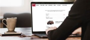 ordering a car on a laptop