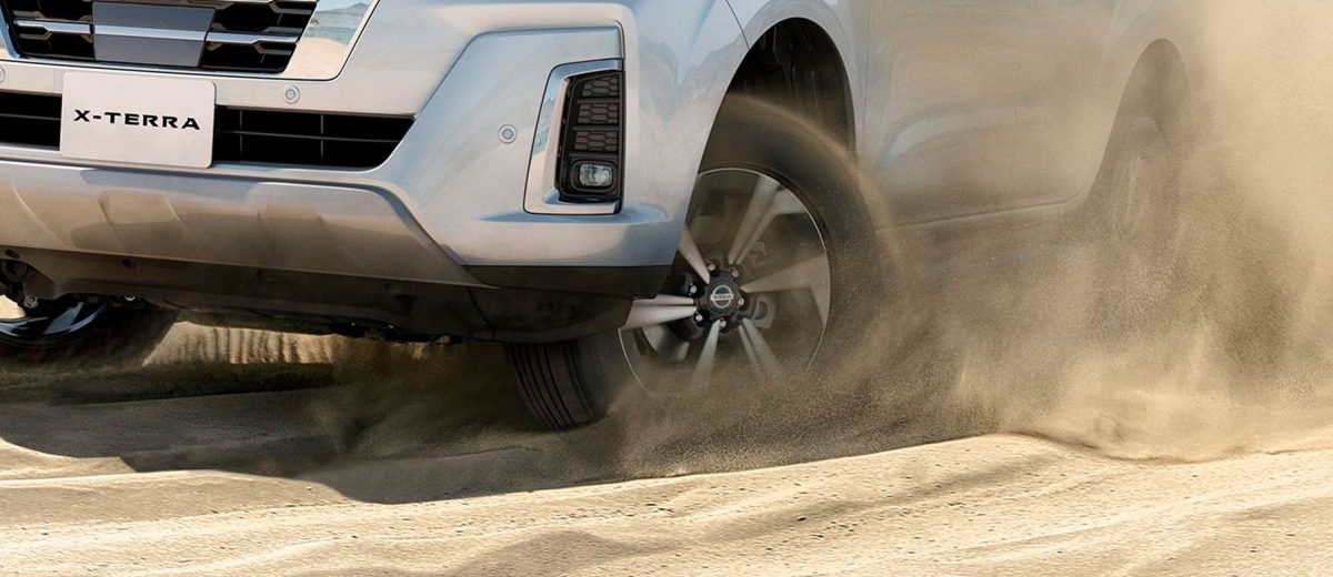 2021 Nissan X-Terra off-road driving through sand dunes