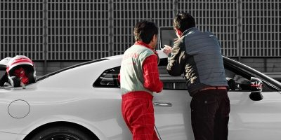 NISMO driver and engineer outside NISMO