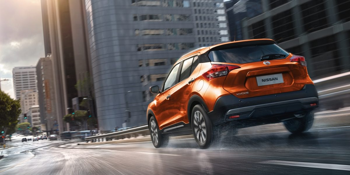Orange and gray Nissan Kicks exterior in parking lot