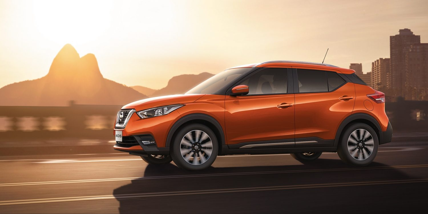 Orange and gray Nissan Kicks exterior on coastal road