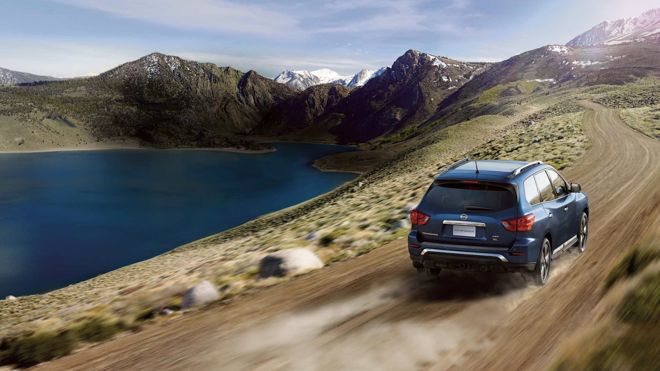 Nissan Pathfinder driving through the mountain