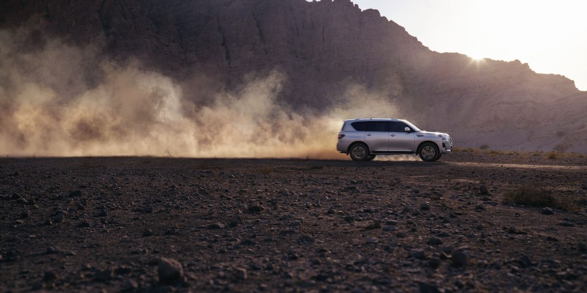 2020 NISSAN PATROL driving at sunset off-road