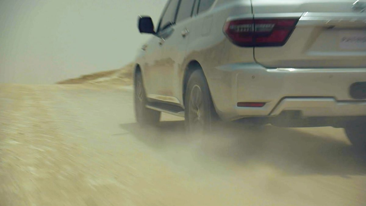 2020 NISSAN PATROL zooming on a desert road