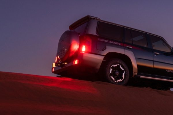 patrol super safari in the desert at night
