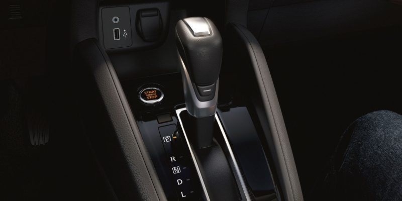 Nissan SUNNY interior showing shifter for CVT transmission