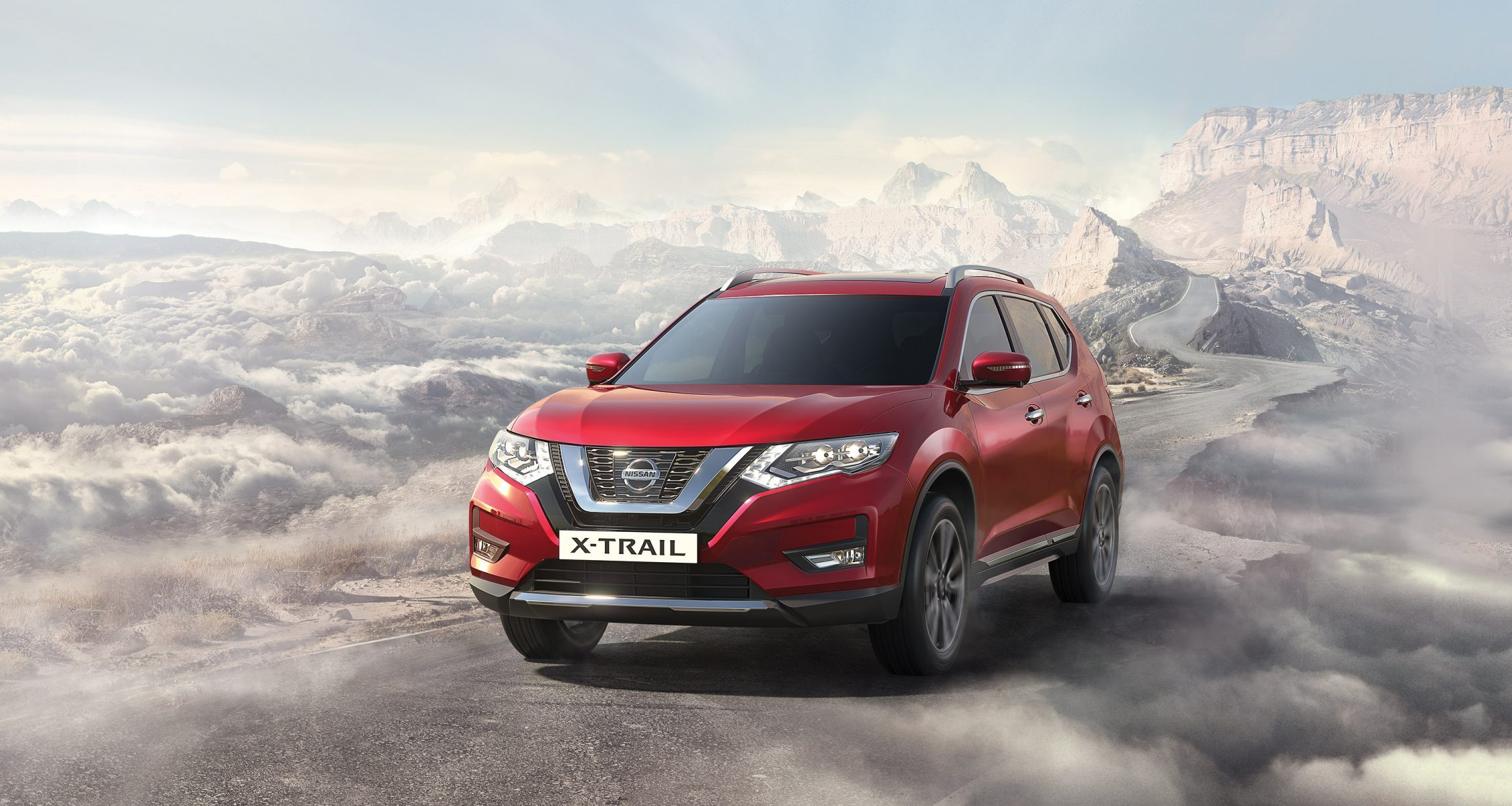 2018 NISSAN X-TRAIL driving on a mountain road