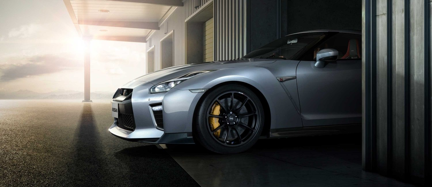 Nissan GT-R driving out of storage garage